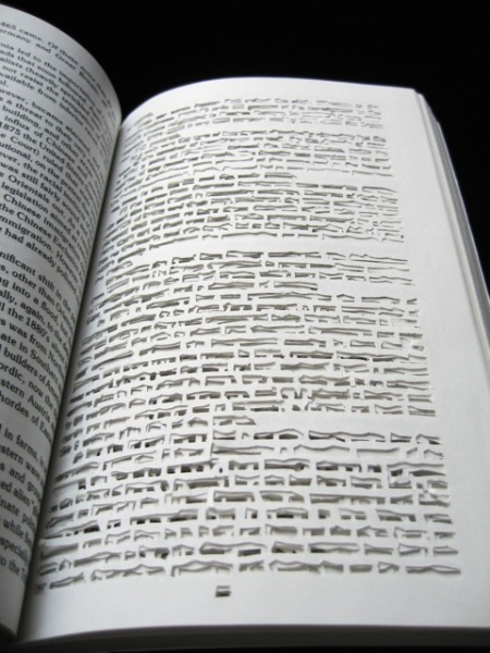 book text art work cutting out words paper black ink
