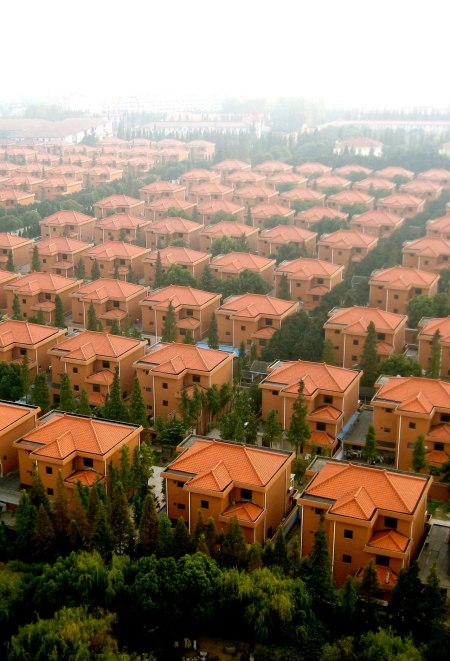 chinese real estate developmen Huaxi Xun thousing architecture communism shares china travel trip village thousand rows of houses look a like