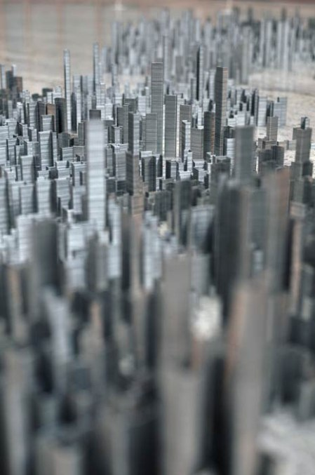 100,000 staples art city stacking skyscrapers artist sculpture exhibition metal city paper stables 3d city blocks towers