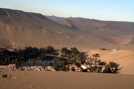 desert landscape trekking sand dune nature adventure holiday sahara peru south america oasis village huacachina