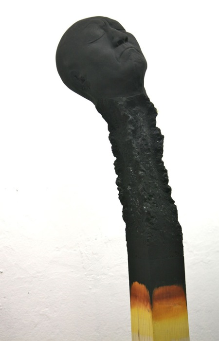 Matchstickmen: Burnt Matches Resembling Charred Human Heads by Wolfgang Stiller wood sculpture art burning faces artist