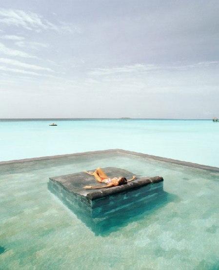 tropical holiday resort ocean water sea spa sunbathing tanning travel wellness lagoon carribean swimming pool