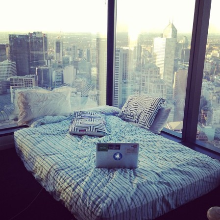 bed new york melbourne city skyline instragram photo sleeping laptop in bed glass corner