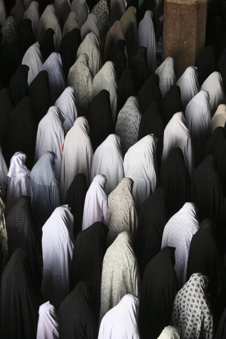 Iranian women perform their Friday prayer at the Imam mosque in the city of Isfahan by Vahid Salemi