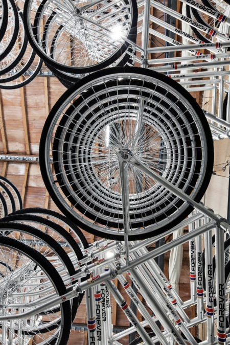 stacked bicycle installation art chinese artist ai weiwei gallery exhibition bikes metal structure stacked vertically art installation