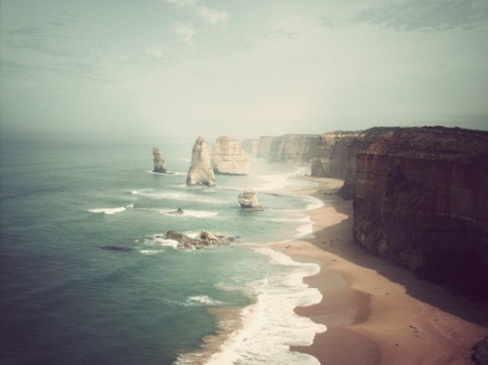 The Twelve Apostles - a collection of limestone stacks off the shore of the Port Campbell National Park, by the Great Ocean Road in Victoria, Australia / photography by De Whalan