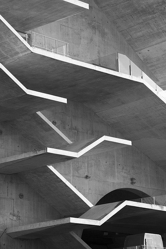 Beautiful black and white photograph of the concrete staircases at Estádio Municipal de Braga, Portugal by famous Portuguese architect Eduardo Souto de Moura