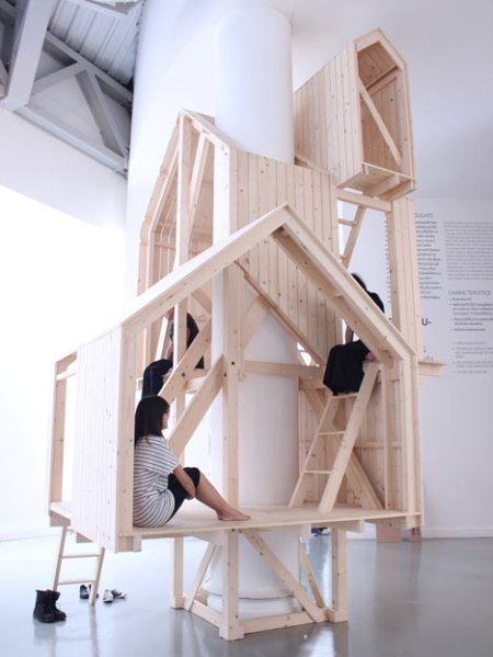 """'Shelter of Nostalgia' -  tree house-like cabins by Thai designer Worapong Manupipatpong, built up around a column of a building rather than over the branches of a tree for the """"Politics of ME"""", an exhibition taking place at the Bangkok Art and Culture Centre in Thailand."""