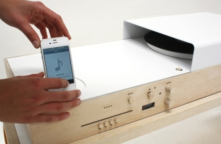 The table is designed in raw wood with sun yellow details and allows you to play both analog and digital music. It's also a turntable for vinyl, a dock for your iPod / iPhone and CD player – all in one.
