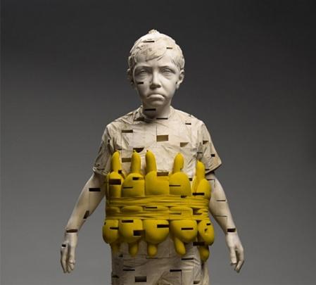 Gehard-Demetz-art-wood sculpturesstrange weird disturbing children faces sculpture instllation wood timber carved out artist art