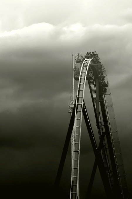 Great monochrome black and white photograph of a roller-coaster in the clouds / unknown photographer