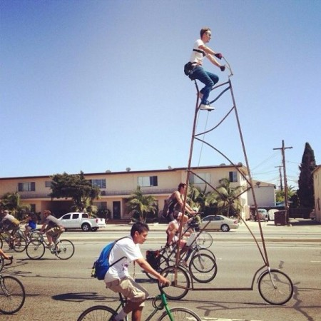 """Richie Trimble's over a hundred pound, 14.5 foot tall bike: """"STOOPID TALL"""" aka """"Big Boy"""" photographed as it made its way from La Cienega to Venice beach, Los Angeles for the Ciclavia 2013."""