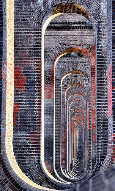 aligned brick walls / Through the arches of the Balcombe viaduct. Extraordinary early 19th century architecture.  Photo taken in West Sussex, England,
