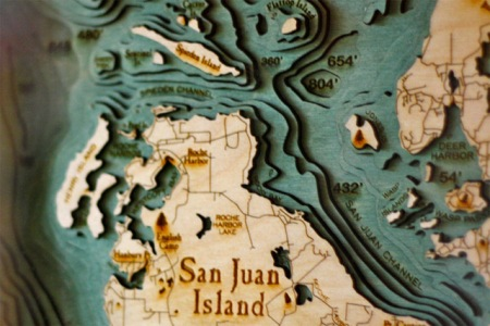 Lasercut Underwater-Topographic maps made from wood by 'Below the Boat'