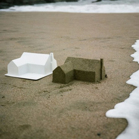 'Master Plan' - sandcastles by Californian designer Chad Wright who in this fantastic artwork recreated a post-war suburbia on a beach by creating a plastic mould that could be filled with sand and lifted off to reveal simplified L-shaped bungalow forms.