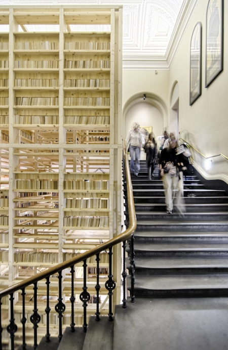 The ARK Booktower by Rintala Eggertsson as part of the '1:1 Architects Build Small Spaces' exhibition back in 2010 at the Victoria and Albert Museum (V&A) in London, UK. The structure consisted of a timber tower with walls of books enclosing a spiral stair case and a central core. The central core was ergonomically scaled to create generous knooks to indulge in one of the many books that made up the walls.
