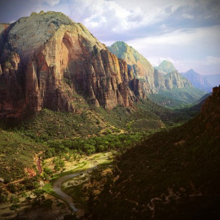 /// Zion National Park is located in the Southwestern United States, near Springdale, Utah. A prominent feature of the 229-square-mile (590 km2) park is Zion Canyon, which is 15 miles (24 km) long and up to half a mile (800 m) deep, cut through the reddish and tan-colored Navajo Sandstone by the North Fork of the Virgin River.