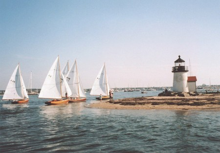 Small Sail Boat racers struggling to finish, fighting the outgoing current. Taken in Nantucket Harbor, MA, USA with an Olympus Infinity Stylus Zoom 140 with Kodak 200 film by Reynal Thebaud