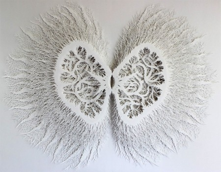 "Incredibly intricate art pieces cut out of paper by artist Rogan Brown who ""creates intricate sculptural forms reminiscent of microorganisms, plant life, and topographical charts by deftly cutting patterns in layer after layer of paper. A single work can take upward of five months to complete, and just like the organic forms he seeks to emulate the piece evolves as he works without a preconceived direction or plan."""