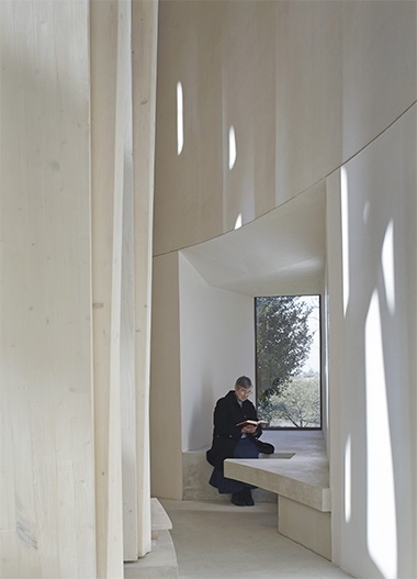 Photos from the interior and exterior of the Ripon Chapel, situated in Oxfordshire. Design by Niall McLaughlin architects.   ///  In the interior space the columns meet to form a filigree vault, allowing light from the clerestory to wash through the chapel. Its central feature is a lectern, emphasising the educational function of the space. From the exterior Its elliptical form presents an uncompromising and 'proper' architecture at ease with the majestic presence of surrounding mature trees.  Its delicate arboreal structure wrapped in an armature of stone, Ripon College's new chapel is a subtle synthesis of nature and the sacred. (via ar)