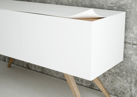 SLAP is a living useful cabinet: it's linear and simple design makes it unique and very versatile, as it can be positioned in every part of the house. The particular edges of this cabinet lets the wood essence to come out, and they're also functional as flap's handy. Material: Wood and Betaflex