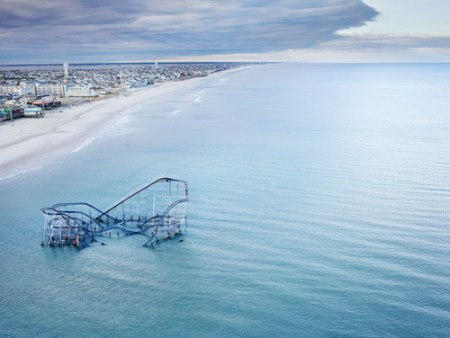 A fascinating capture of a partly submerged roller coaster at the Seaside Heights Boardwalk in New Jersey after Hurricane Sandy on November 4th 2012 - photographed by Stephen Wilkes