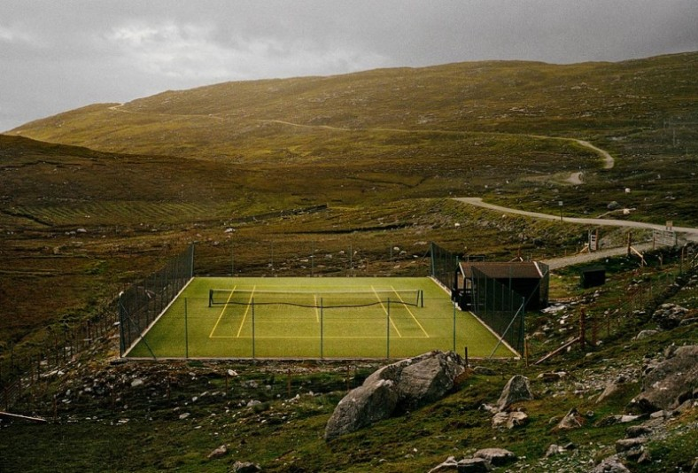 Remote tennis court in the Hebrides, an area off the west coast of the Scottish mainland, photographed by Paris based photographer Derek Hudson.