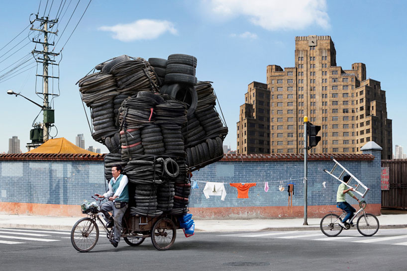 In his series 'Totems' set in Shanghai, China french photographer Alain Delorme pays homage to the underdog heroes of the city, migrant bicycle workers lugging around heaps of cargo to keep the ever-expanding city afloat. Delorme turns this real injustice into a surreal circus whereby he digitally alters his photos to better convey his message about the wealth disparity in China.  Hereby the migrants' loads have been digitally retouched and purposefully exaggerated to draw attention to the symbolism within Delorme's work. In addition, the photographer uses candy-coated hues to veer away from reality.