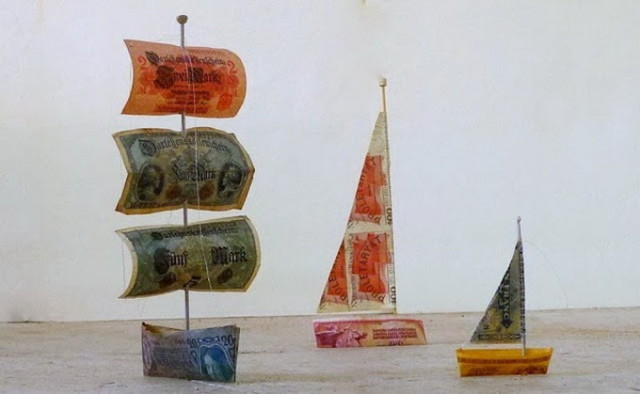 Sail Away - a constantly expanding, large-scale installation in the Turbine Hall of Tate Modern in London, consisting of hundreds of small boats made from paper money bills, maps and tickets from all around the world.  by artist Susan Stockwell