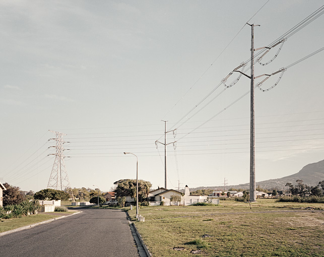 "From his series ' Means to an End' - a set of photographs documenting electricity pylons that can be found criss-crossing the landscape around the city of Cape Town, South Africa by local photographer Marsh Dillon:  ""I was drawn to the seemingly haphazard variations of their designs and the cryptic reasoning behind their structuring"""