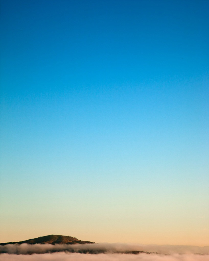 This photographic series by New York photographer Eric Cahan was created by adding filters with a variety of cameras that are both film and digital. Influenced by the California light and space movement, Cahan is interested in achieving an experience of light and color that is seamless and that transcends reality, much like his predecessors like Turrell in the 1960s. Through repetitive printing and filtering, Cahan eventually achieves these finished skyscapes that feel simultaneously surreal and hyper-real, revealing the seemingly magical phenomenon of light as we might experience it ourselves, but as many photographs fail to capture. (Text by Juxtapox.com)