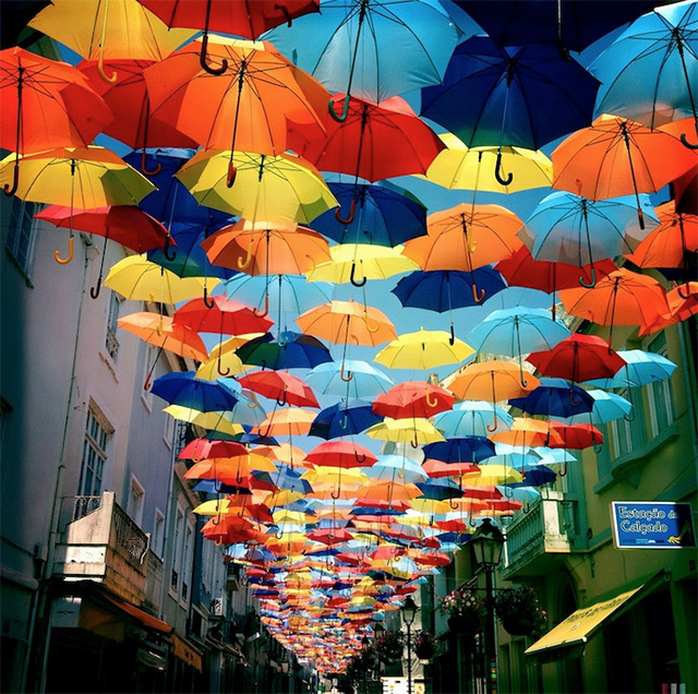 A Colorful Canopy of Umbrellas Returns to the Streets of Agueda, Portugal (1)